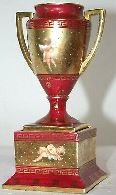 Antique Mini Gilt Porcelain French Double Handled Urn W/ Painted Putti Scenes.