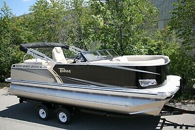New 22 Tritoon with 175 new four stroke and trailer