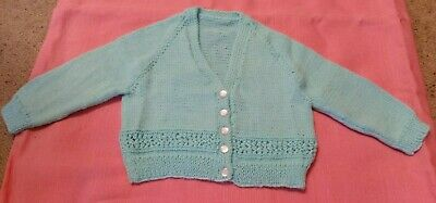 Aqua Cardigan In Size 1 With a Cute Pattern At The Bottom Of The Back And Front