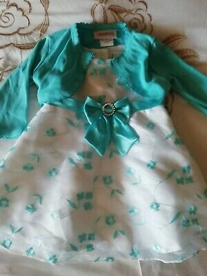 Brand new without tags baby girls dress size 6-9 months