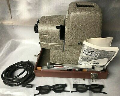 Clean TDC Vivid Stereo Model 116 projector with case and other items