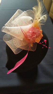 Fascinator - peach sinamay with flower & peach mounted feathers on a clip & pin