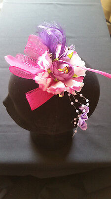Fascinator -Purple sinamay with flower& beads & feathers mounted on a clip & pin