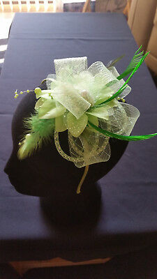 Fascinator - Green sinamay with flower, feathers and beads mounted on a headband