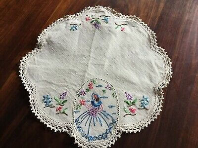 Vintage beige doily with hand embroidered crinoline lady.