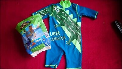 bd683c299c baby boys swimsuit 9-12 months and a few swimming nappies