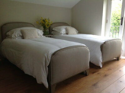 Pair of antique beds with new upholstery