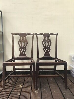 Four Georgian Chippendale style  dinning chairs one of which is a carver.