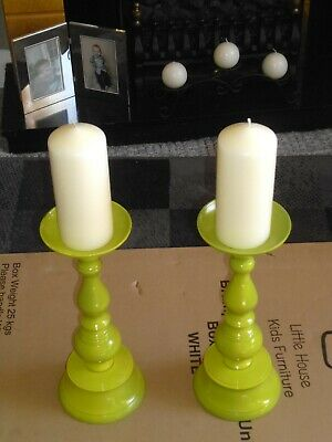 A Pair Of  Metal Candlesticks. with candles