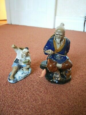two Chinese Shiwan fishman figures