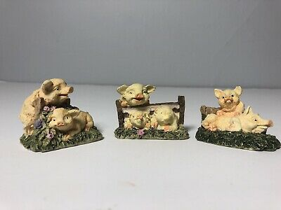 Cute pig figurines - lot of three farm collectible decor - pigs in grass flowers