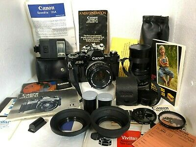 Canon AE-1 Black Body 2 lenses, Manuals, flash, Filters, film, and camera bag.