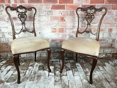 A pair of Victorian Mahogany dining chairs.