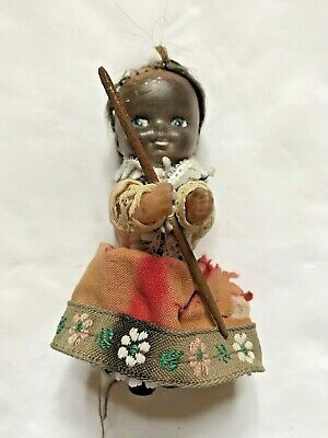 Vintage Tiny Doll Holding a Sewing Needle