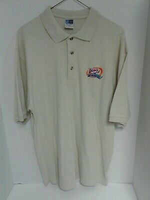 """COLLECTIBLE LANCE SNACK SHIRT SIZE IS LARGE COLOR IS TAN """"New Beginning"""" logo"""