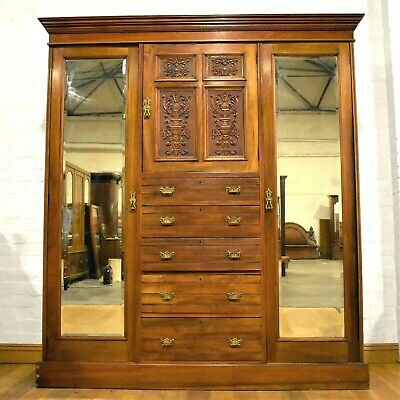 Antique carved Victorian triple combination wardrobe