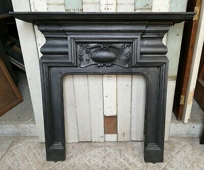 AN ELEGANT LARGE VICTORIAN CAST IRON FIRE SURROUND FOR WOOD BURNER ref FS0070