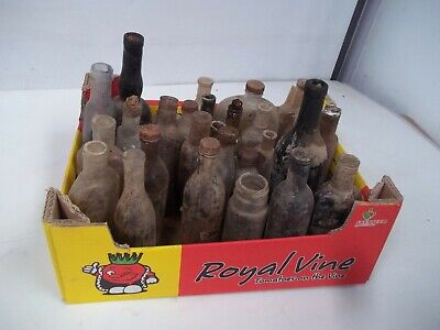 32 assorted old glass bottles in the condition they were found dug up in france.