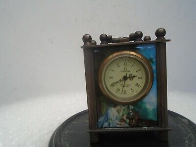 Amazing miniature OMEGA carriage clock with decorated panels including nude