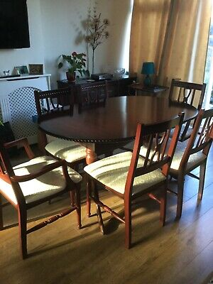 Mahogany extending dining table and six chairs with matching sideboard.