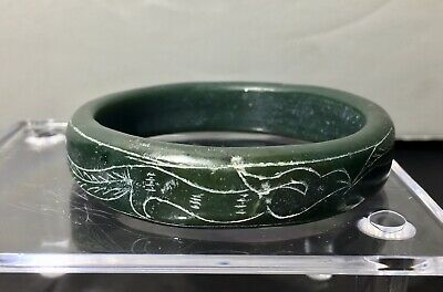 An Antique Chinese Spinach Jade Bangle with Phoenix & Lotus Carving