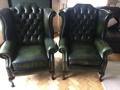 A pair of Winged High-Back Chesterfield Queen Anne Armchairs dark green leather
