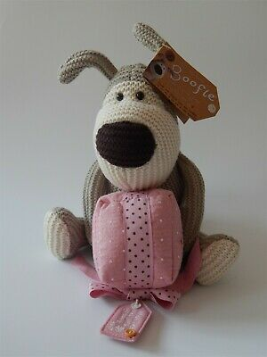 Boofle soft knitted dog toy, carrying a pink parcel, with original tag attached