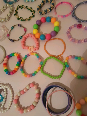 50 pieces little girl's cute bracelets mostly new / all squeaky clean