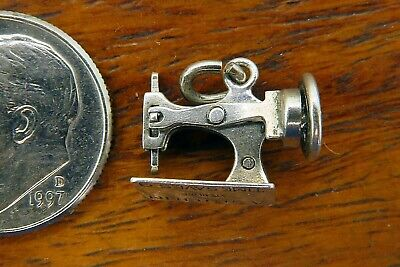 Vintage silver A STITCH IN TIME SAVES 9 SEWING MACHINE WHEEL NEEDLE MOVES charm