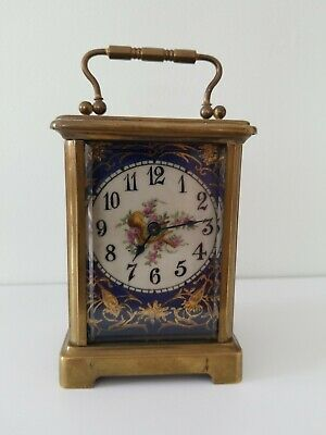 Porcelain maunted carriage clock