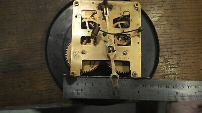 old clock movement brass with dial