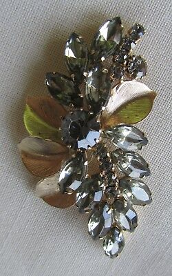 Vintage gold tone flower brooch with grey rhinestones