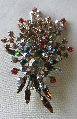 Vintage gold tone oversized flower brooch with coloured rhinestones