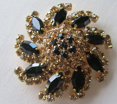 Vintage gold tone flower brooch with black and brown rhinestones