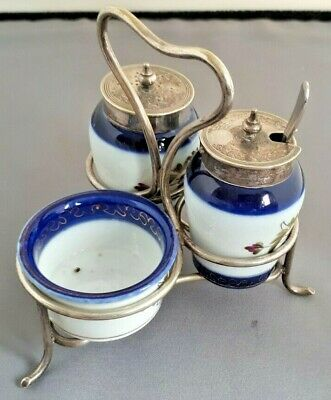 Vintage decorated condiment set with silver plate lids and carrier