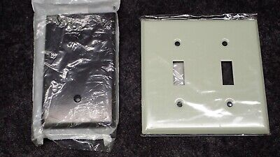 (1) Leviton 85019 Black Cover Plate and (1) TayMac White Dbl Toggle Wall Plate