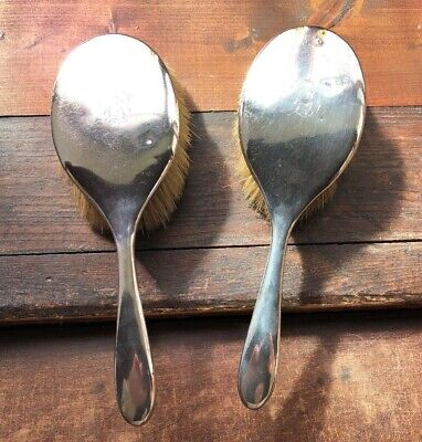 Two antique silver hand mirrors