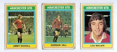 3 1975 Topps Grey & Blue Back Football cards featuring Manchester United players