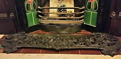 Victorian cast iron decorative fireplace fender with  floral and shield pattern