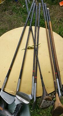 8 old golf clubs woods, putters.