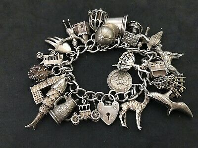 Vintage Sterling Silver Charm Bracelet with 22 Silver Charms. 102 grams!