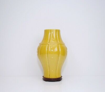 A Yellow Glazed Vase with Wooden Stand
