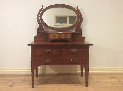 Restored Antique Blackwood Five Drawer Dressing Table with Oval Mirror.