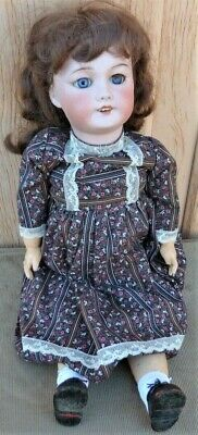 Antique Bisque French Doll with outfit. SFBJ  301 Paris. Good Condition.