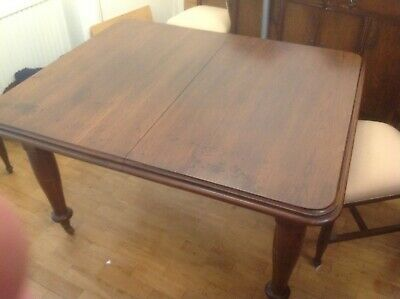 Oak extending dining room table plus 5 chairs