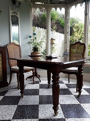 Antique Victorian Mahogany extending dining table, carved &fluted legs, castors.