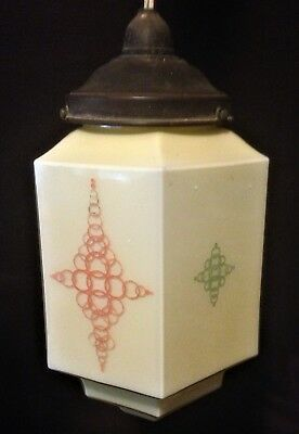 Art deco light shade - hexagonal with green and orange patterns on each side.