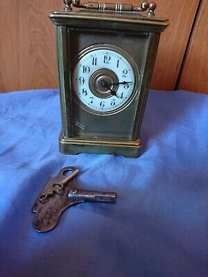 A Fine Antique French Masked Dial Carriage Clock