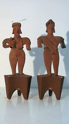 Pair of Pre-Columbian Colima figurines on stands, female holding dog-100BC-200AD
