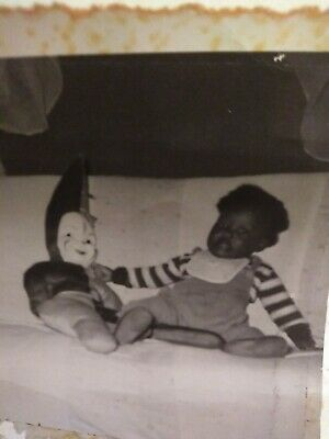 Segregation photo African American girl an white face Doll from Houston Texas